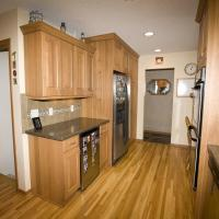 Beverage fridge and primary refrigerator with white oak flooring