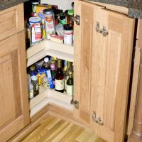 Lazy susan with articulating door
