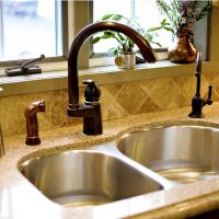 Undermount stainless steel sink with oil rubbed bronze faucet fixtures