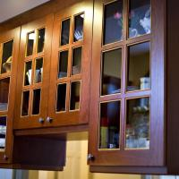 Center island upper cabinets with glass doors